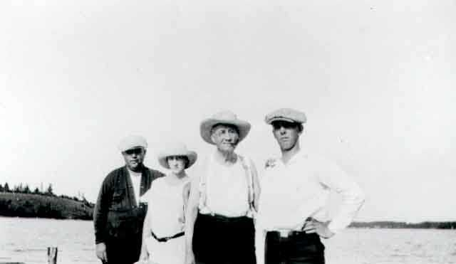 Black and white photograph of Daniel Hogan (far left) and family, c.1926. Hogan was was instrumental in the operation of the O'Connor system.
