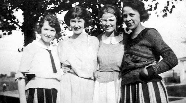 Black and white photograph of Ethel Ray (later Ethel Ray Nance; far right) with Myrtle Hultberg, Mabel Jackson, and an unknown individual, ca. 1922.
