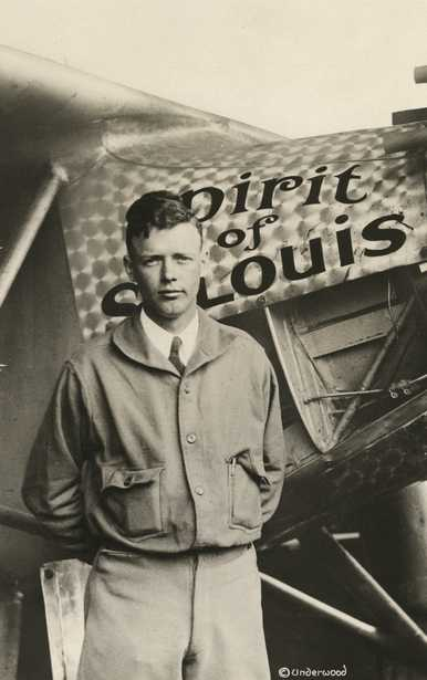 """Black and white photograph of Charles Augustus Lindbergh with the """"Spirit of St. Louis,"""" c.1928."""