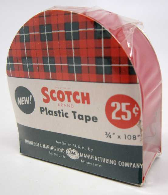 photograph of a plastic wrapped container of Scotch household tape