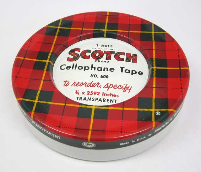 photograph of a red plaid scotch tape container