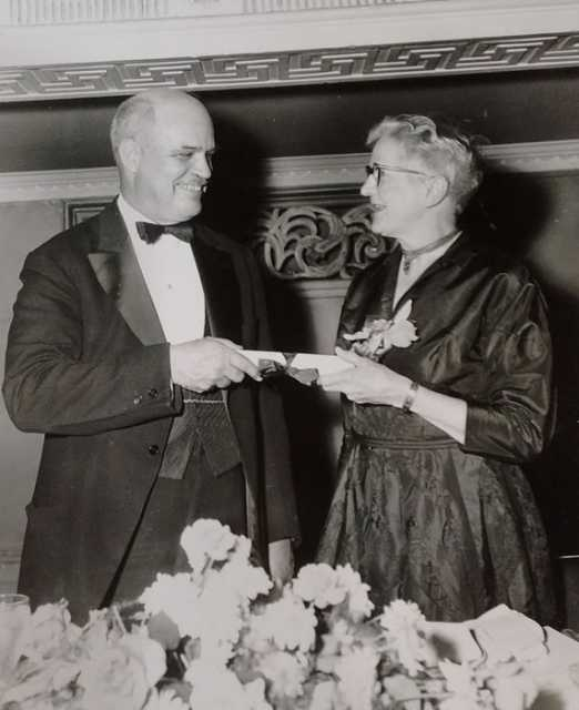 Black and white photograph of Frances E. Andrews at a National Audubon Society dinner, 1954.