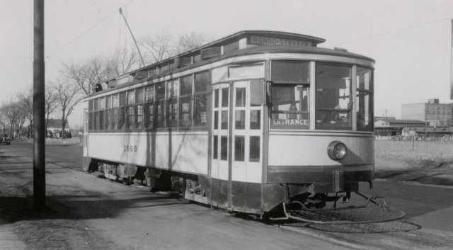 Black and white photograph of a streetcar at Rondo Avenue and Griggs Street, 1947.