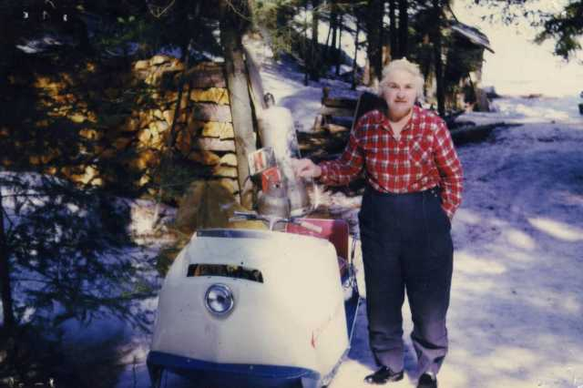 Color image of Dorothy Molter with her Polaris Mustang snowmobile, Isle of Pines, Knife Lake, Boundary Waters Canoe Area, ca. 1970s.