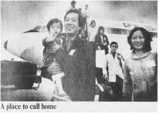Black and white photograph of Indochinese refugees arriving in Iowa, 1979.