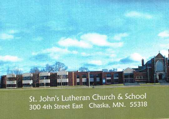 St. John's Lutheran Church and School at 300 4th Street East in Chaska, MN. The church is the long, three-story building; the church is on its far right side. Note the steeple at the far right of the church. Image rights retained by the Carver County Historical Society.