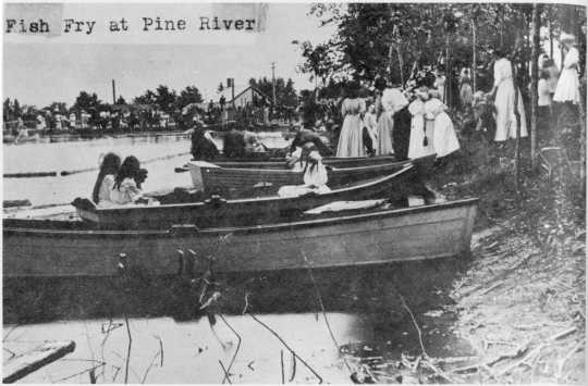 Children in boats at Pine River Fish Fry, 1920s.