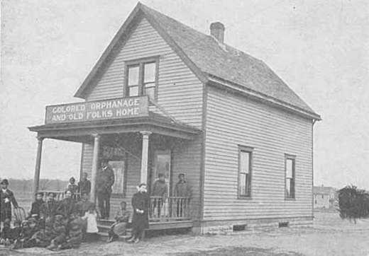 Black and white photograph of the Crispus Attucks Orphanage and Old Folks Home at its original location on East Acker Street in St. Paul, c.1905.