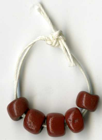 Color image of dark red trade beads.