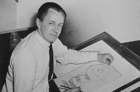 Charles Schulz with a drawing of Charlie Brown