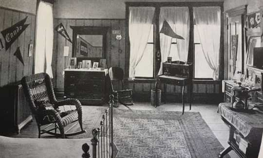 Black and white photograph of a student bedroom inside Graham Hall, 1912 or 1913.