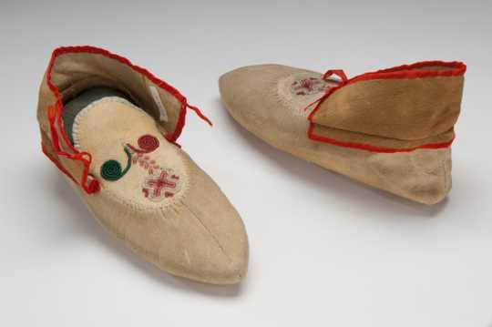 "Color image of Dakota beaded and ribbonwork moccasins, made by Sarah Good Thunder (Dakota), 1904. Inscribed: ""Made by Mrs. Good Thunder for Mrs. Whipple 1904."""