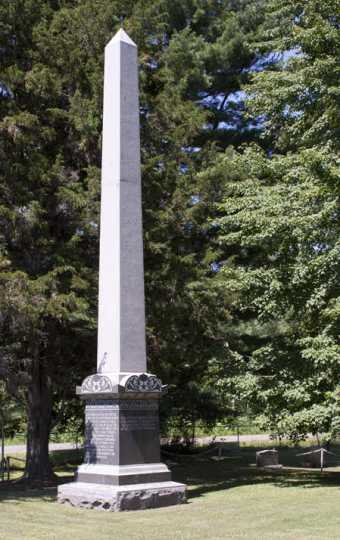 Color image of the obelisk monument in Brook Park Cemetery commemorating the victims of the 1894 fire, August 7, 2017. Photograph by Alan W. Slacter.