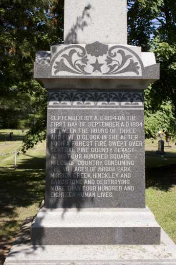 Color image of the base of an obelisk monument in Brook Park commemorating the victims of the 1894 fire, August 7, 2017. Photograph by Alan W. Slacter.