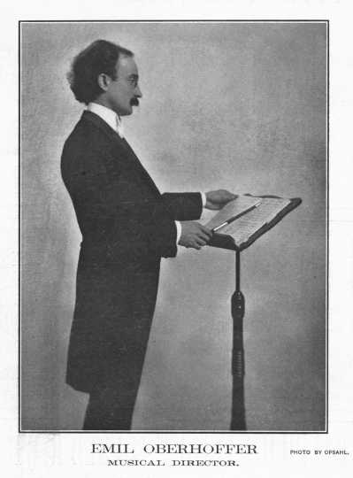 Black and white photograph of Oberhoffer at behind a podium, c.1903.