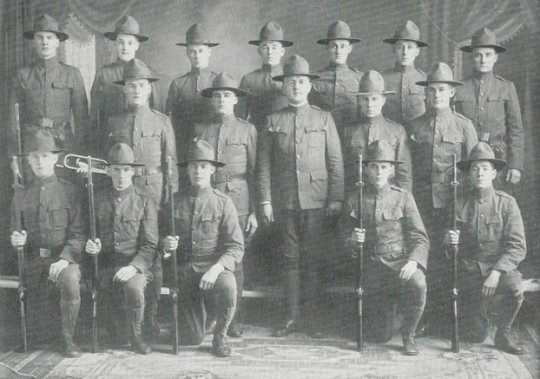 Black and white photograph of corporals in military drill squad, 1918.
