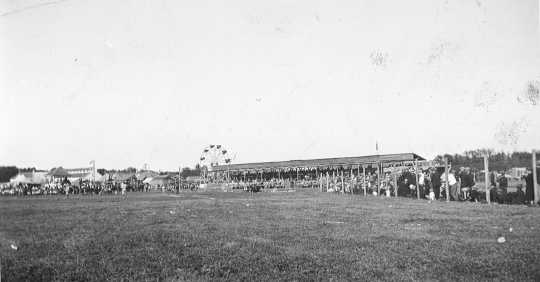 Black and white photograph of the grandstand at the Murray County Fair in Slayton, 1925.