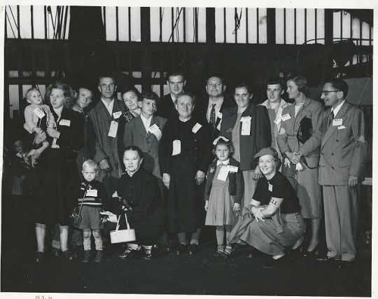 International Institute Committee welcoming refugees in New York Harbor, 1952