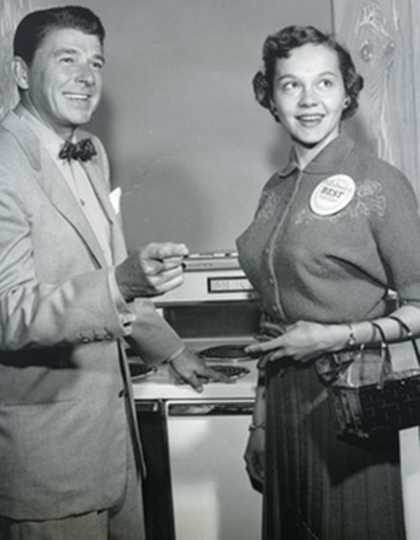Black and white photograph of Beatrice Ojakangas from Duluth, MN and Ronald Reagan at the Bake-Off in Los Angeles, 1957.