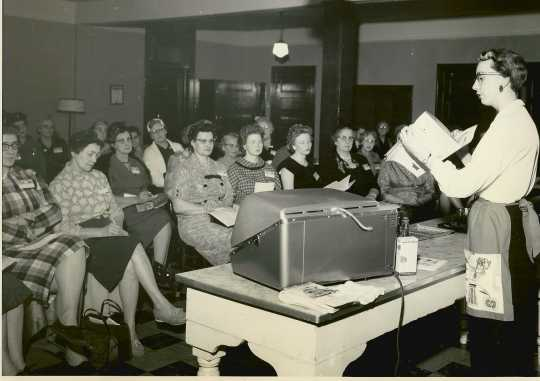 Black and white photograph of Lois Fankhanel teaching a class at a workshop for Farm Bureau women, 1960.