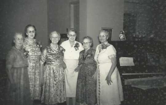 Black and white photograph of BPWC's original charter members at the club's fortieth anniversary celebration, 1961. Pictured (left to right) are Anna Brustad, Pauline Lohn, Mae Rideout, Ida Twedten, Sue Monroe, and Dr. Blanche Sharp.