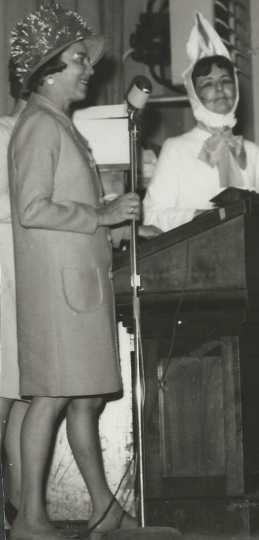 Black and white photograph of Mrs. Ardis Hiller (left) and Mrs. Ross (right) at a BPWC fashion show, 1961.