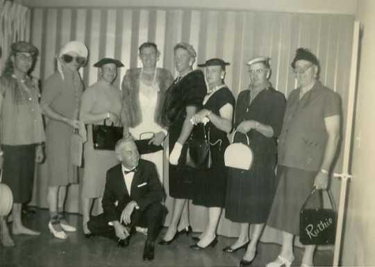 Black and white photograph of a Farm Bureau men in fashion show, 1962.