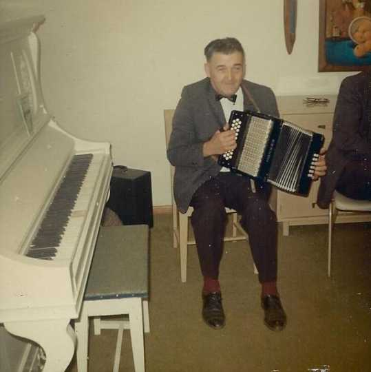 "Color image of Bruno Jurchen with his ""Old Faithful"" squeezebox, 1967."