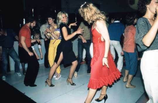 Color image of Disco dancers at Uncle Sam's, ca. 1977. Photograph by Steven Laboe.