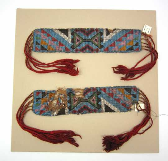 Color image of loom woven garters that originated in the area around Selkirk, Manitoba, and are possibly Ojibwe, Métis, or Cree, ca. 1820s.
