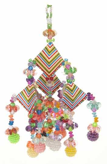 Color image of a Paj ornament made by May Yang, c.1982.