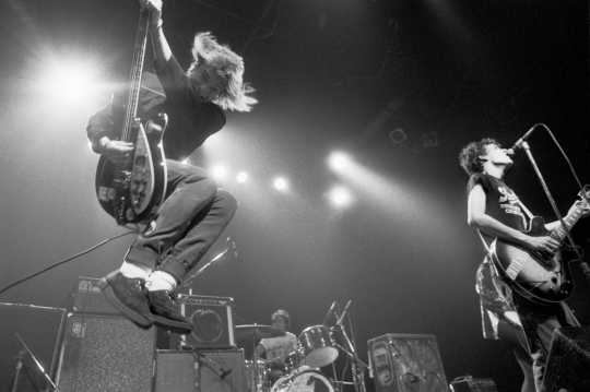 Black and white photograph of the Replacements performing at First Avenue, ca. 1985. Photograph by Daniel Corrigan.