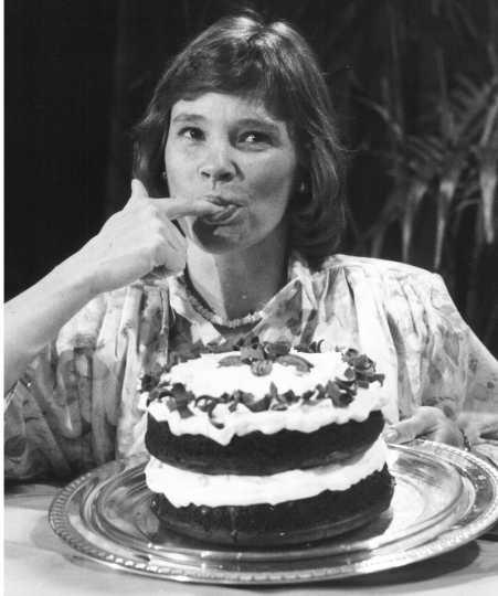 Black and white photograph of Bake-Off Grand Prize Winner Julie Konecne (Bemidji, MN) tasting her chocolate pecan praline layer cake, 1988.