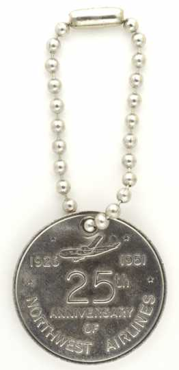Color image of a Northwest Airlines silver anniversary medallion, 1951.