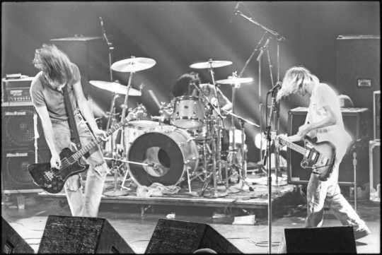 Black and white photograph of Nirvana performing at First Avenue, October 14, 1991. Photograph by Jay Smiley.