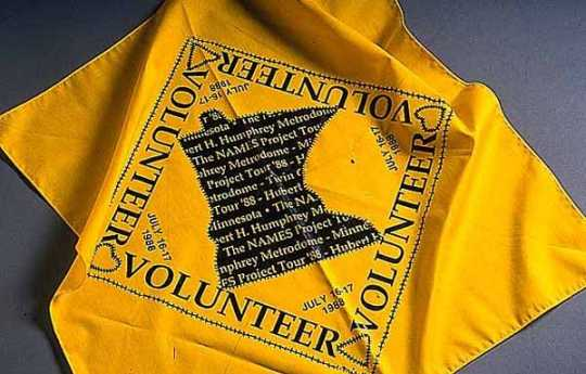 Color image of a Cotton bandana given to volunteers when the AIDS quilt was shown at the Metrodome, 1988.