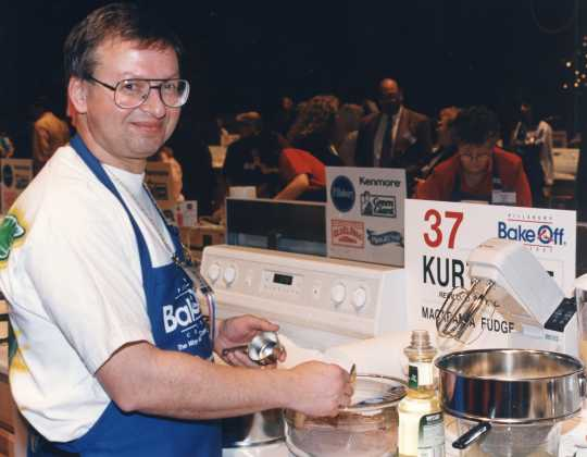 Color image of Bake-Off Winner Kurt Wait (Redwood City, CA) baking macadamia fudge torte. He was the first and only male grand prize winner, 1996.