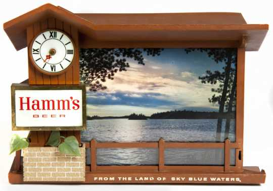 """A promotional item produced by Hamm's Brewing Company ca. 1950. This clock shows a cabin scene that embodies the essence of Hamm's early advertising campaign around the """"cool refreshment of Minnesota's vacationland."""""""