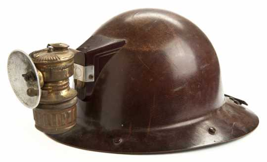Color image of a rimmed miner's helmet worn by Adam Shapic circa 1910-1930s