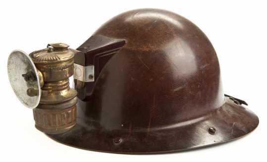 Iron miner's helmet with lamp