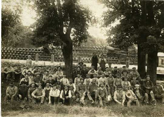 Photograph of a group of factory employees