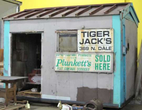 """Color image of Store specializing in """"do-it-yourself products"""" owned by Tiger Jack Rosenbloom, 2002. The structure stood at the corner of Dale Street and St. Anthony Avenue in the Rondo neighborhood of St. Paul between 1949 and 2002."""