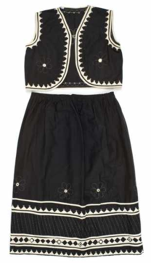 Color image of a child's black-and-white cotton vest and skirt made in India, 1967.
