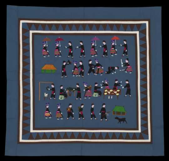 Color image of a Hmong paj ndaub, or story cloth, illustrating Hmong New Year activities. Made in Ban Vinai, Thailand, c.1989.