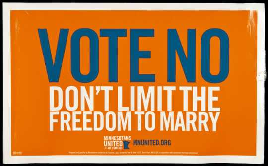 Color image of a cardboard lawn sign distributed by Minnesotans United for All Families in opposition to the Minnesota Marriage Amendment, proposed in 2012.