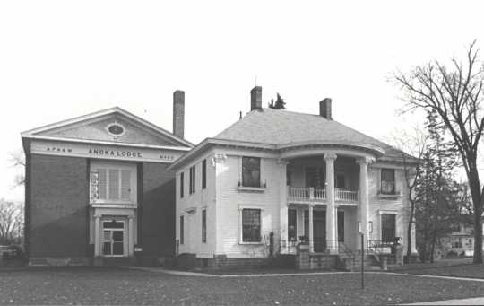 Photograph showing Colonial Hall (right, built in 1904) after Masonic Lodge No. 30 (left, built in 1922) was built beside it. Photographer unknown, ca. 1970s.