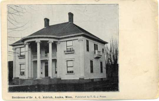 Postcard with image of Colonial Hall, residence of Drs. Alanson and Flora Aldrich. Photographer and date unknown; possibly taken shortly after the home was built in 1904. Used with the permission of the Anoka County Historical Society.