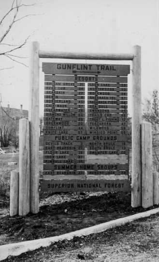 The entrance sign to the Gunflint Trail. Photographed on May 11, 1939, by the United States Department of Agriculture, Forest Service Region 9. Public domain.