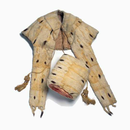 Color image of woman's white ermine tippet and muff set made c.1840.