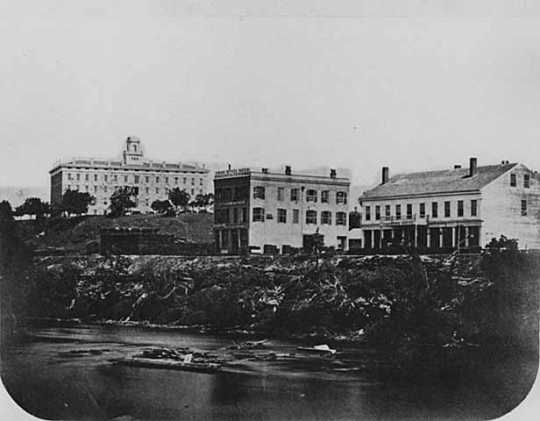 Black and white photograph of view of Winslow House, Upton Block and Jarrett House, St. Anthony.